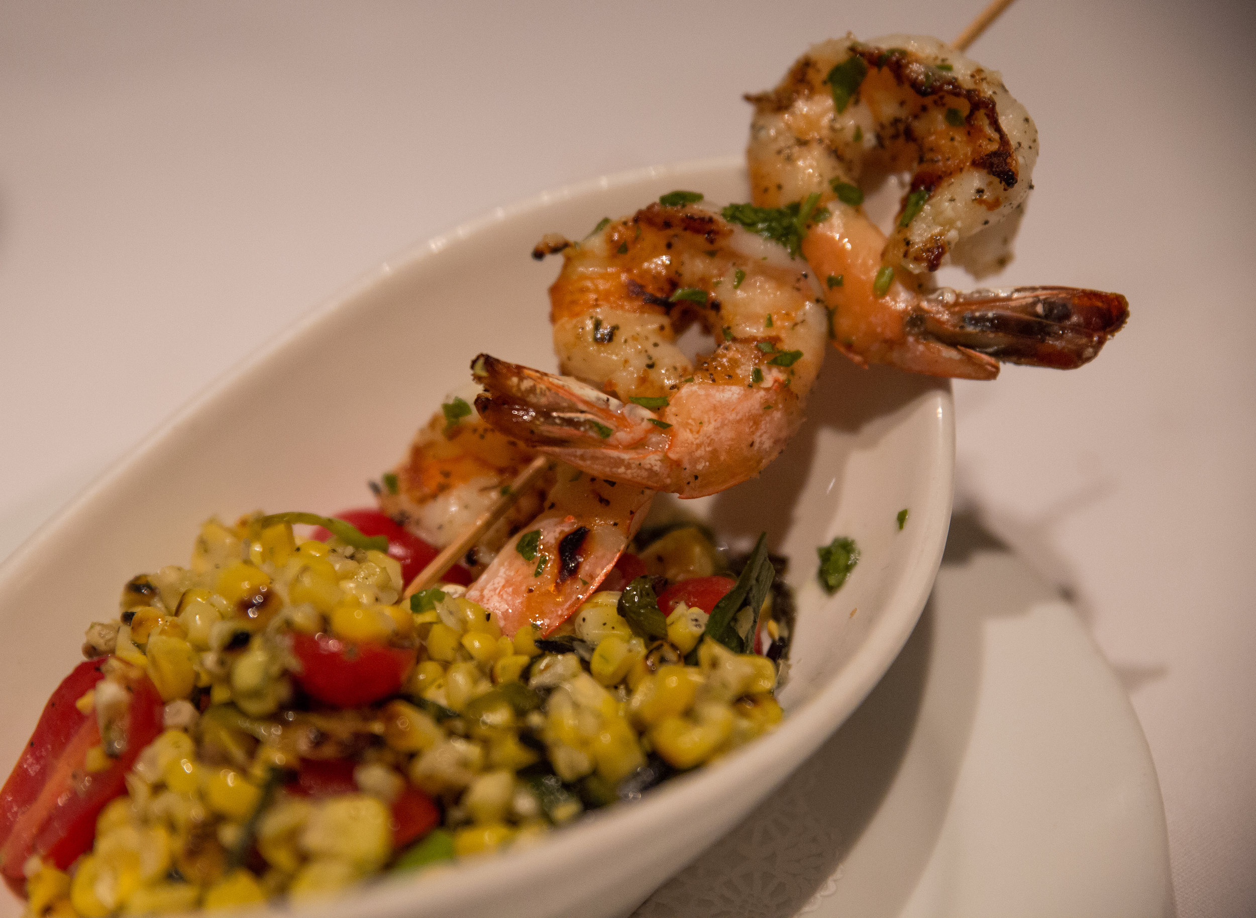 The Grilled Shrimp appetizer is the perfect blend of smoky grilled shrimp paired with a chilled corn salad with a refreshing citrus dressing. (Photo / Craig D'Andrea).