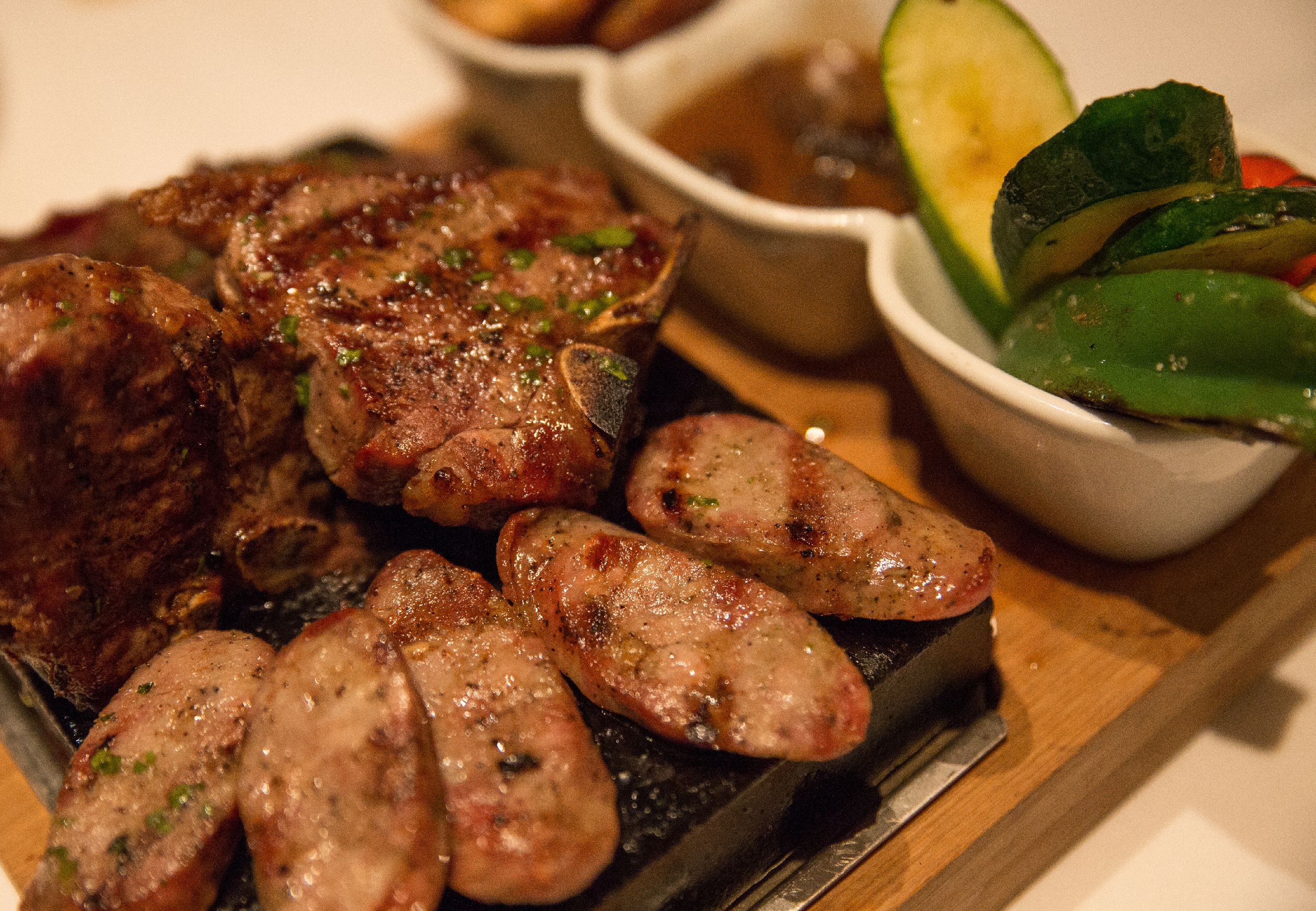 For a true feast, try the the Mixed Grill For Two which offers up assorted cuts of sweet sausage, skirt steak, short ribs, chicken, lamb T-bone, black sausage, season vegetables and potato fries. (Photo / Craig D'Andrea).