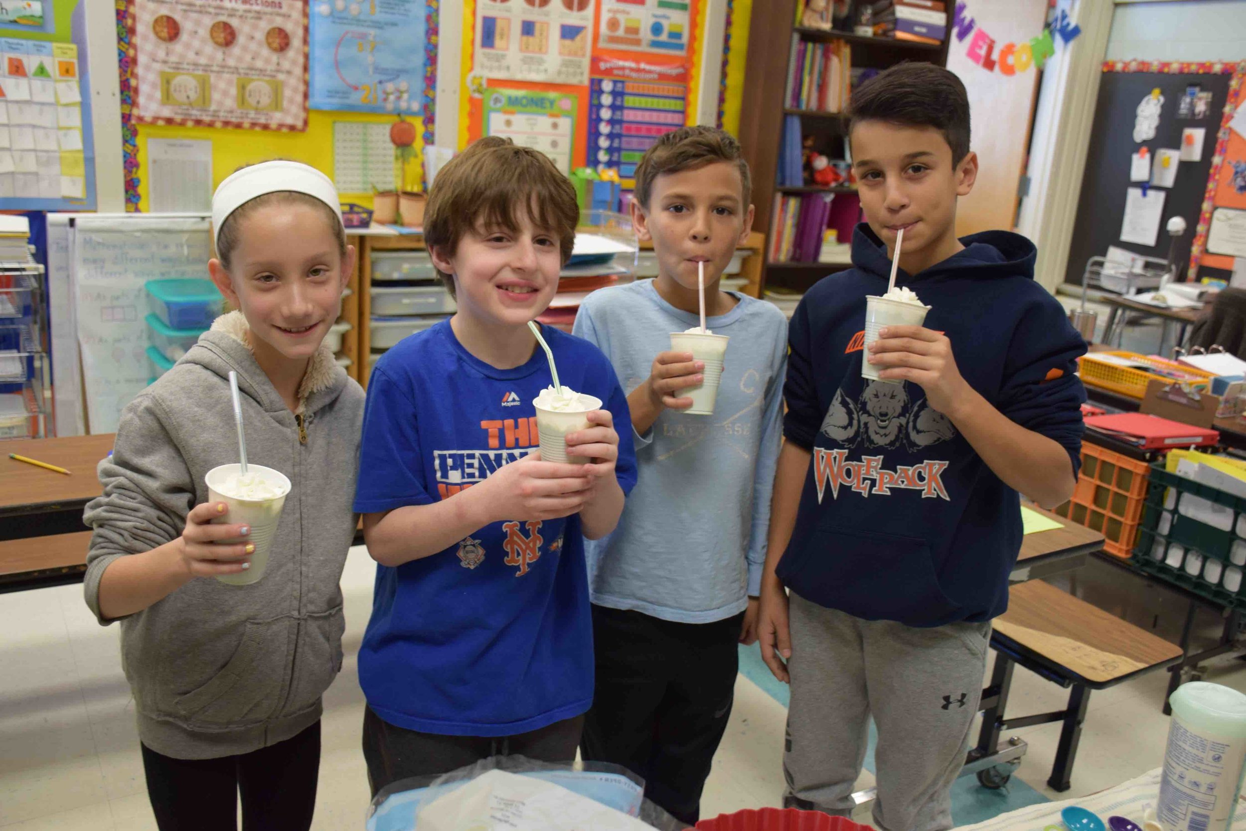 Photo/Harborfields School District   Pictured above, from left, enjoying their Shamrock Shakes are: fifth-graders Ava DePaolis, Michael Alberti, Shane Hansen and Vincent Bolognino.
