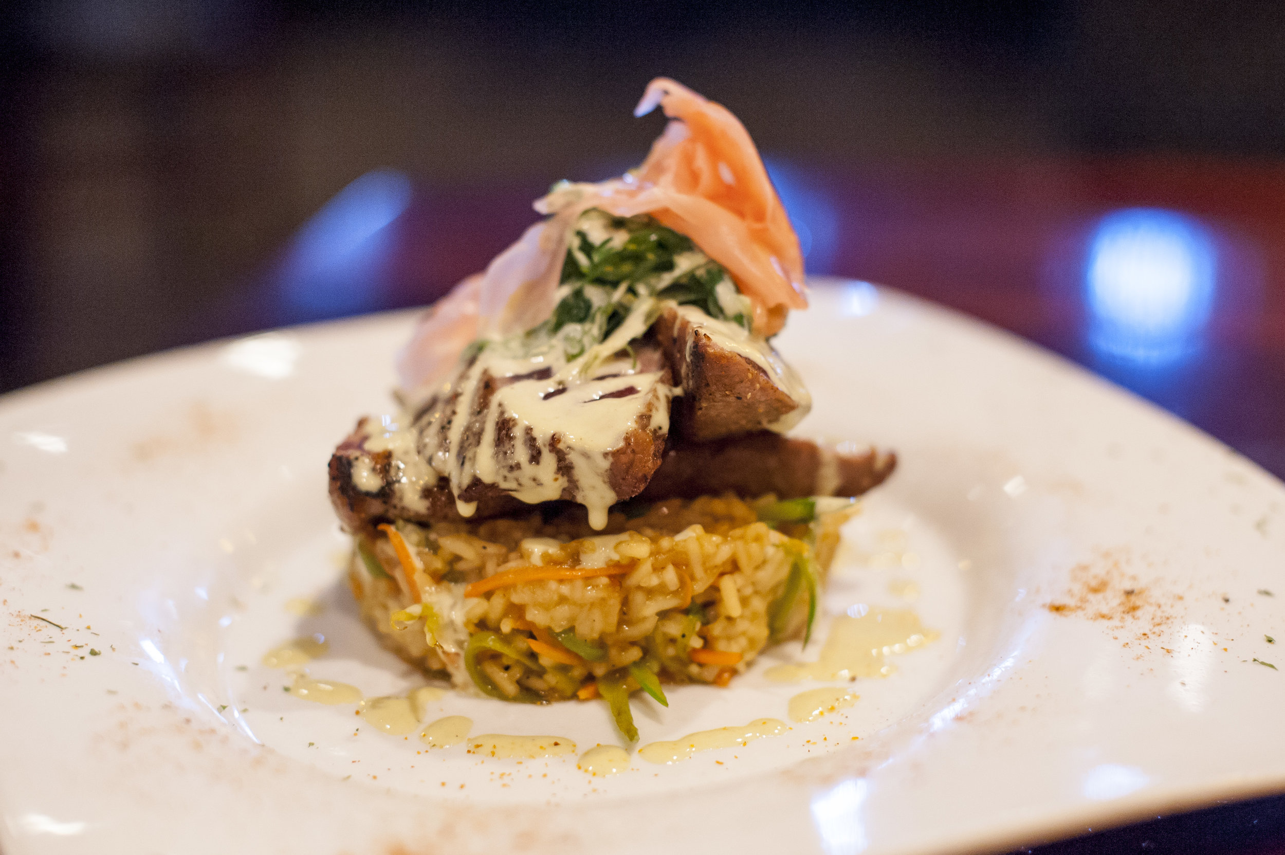 The Cajun Dusted Yellowfin Tuna pairs stir fried rice, seaweed salad, pickled ginger and wasabi aioli for a delicious cornucopia of Asian flavors.