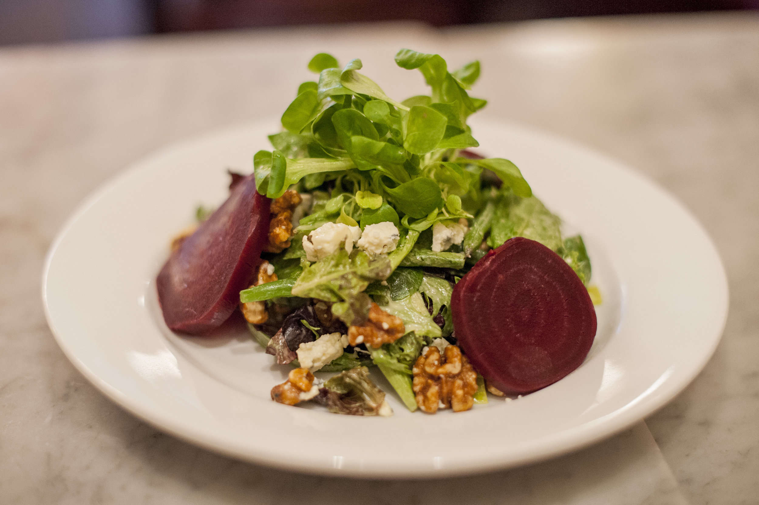 Long Islander News photos/Jano Tantongco The Salade Cassis features microgreens, Roquefort cheese, roasted beets, walnuts, French beans, poached leeks and dijon vinaigrette, creating a mix of bold and fresh flavors.