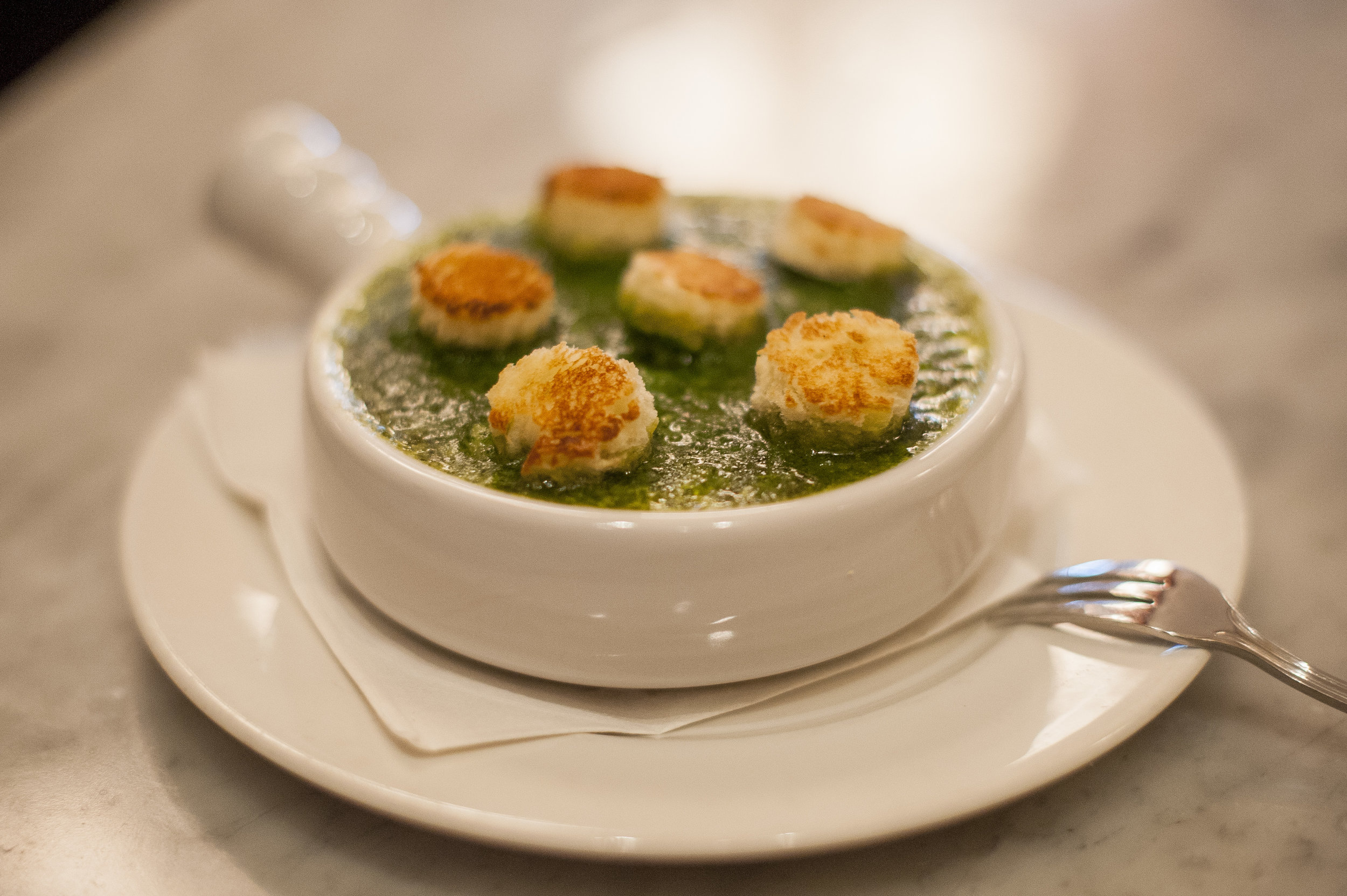 An authentic take on a French staple, the Escargots Persilles are baked snails and garlic herb butter, topped with bread croutons.