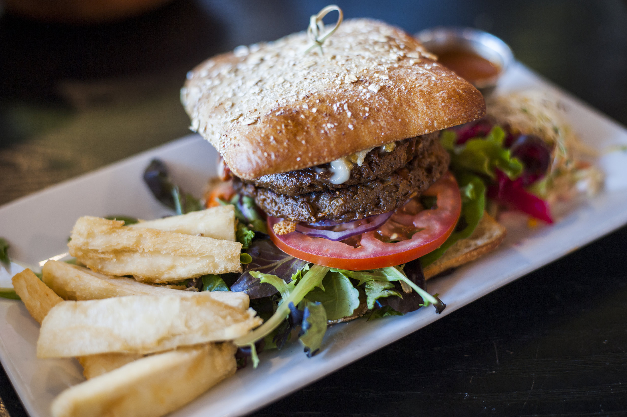 Between whole wheat ciabatta, The Proper Whopper brings together vegan burger patties, melted vegan cheese, secret sweet & spicy sauce, red onion, tomato, organic baby greens with a helping of yuca fries.