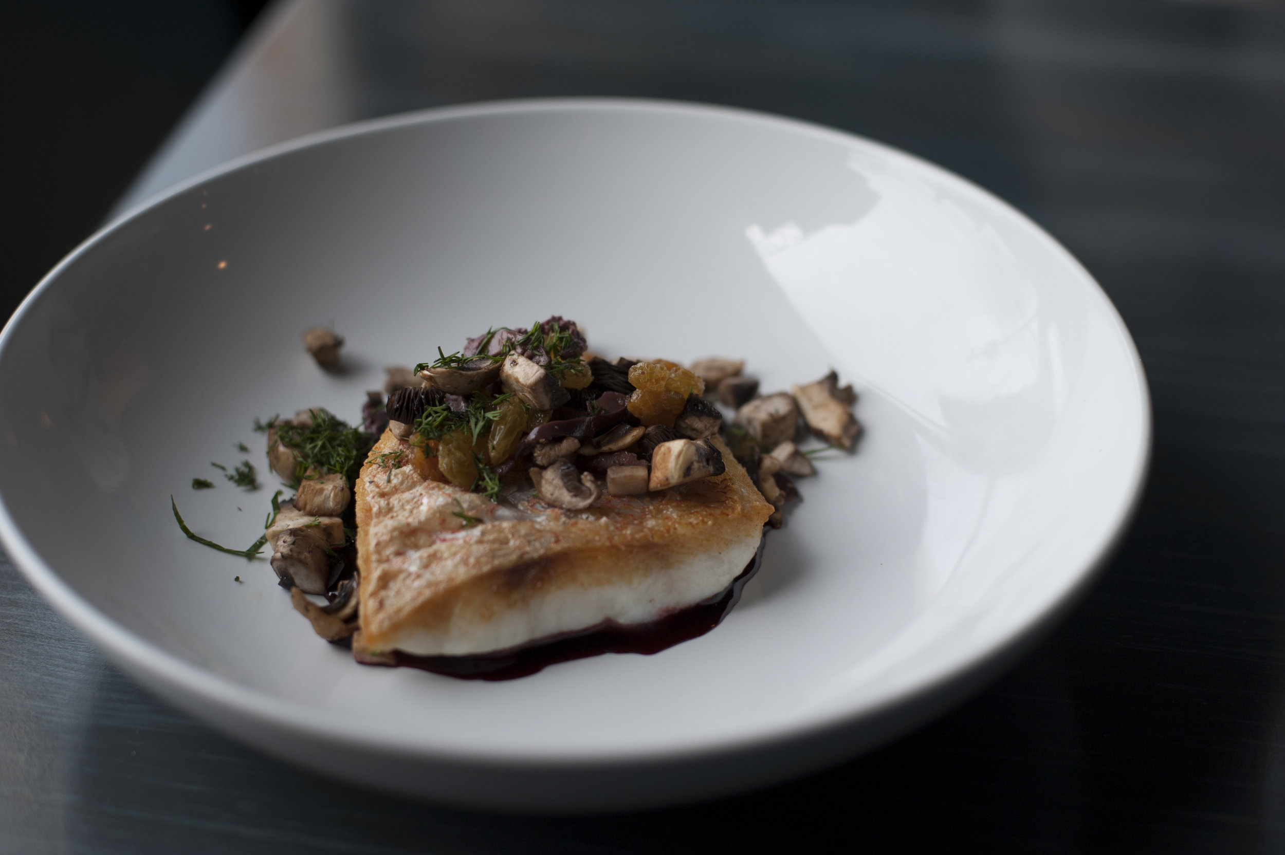 The Mediterranean Red Snapper brings together fillet of red snapper served with red beet beurre blanc sauce, topped with olives, golden raisins and mushrooms for a rich and complex dish.