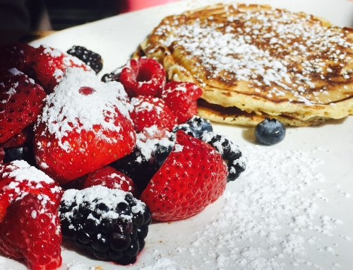 Treat mom next weekend to a meal on Mother's Day, such as brunch at IMC Restaurant in Huntington. Pictured, IMC's pancakes and seasonal fruit.