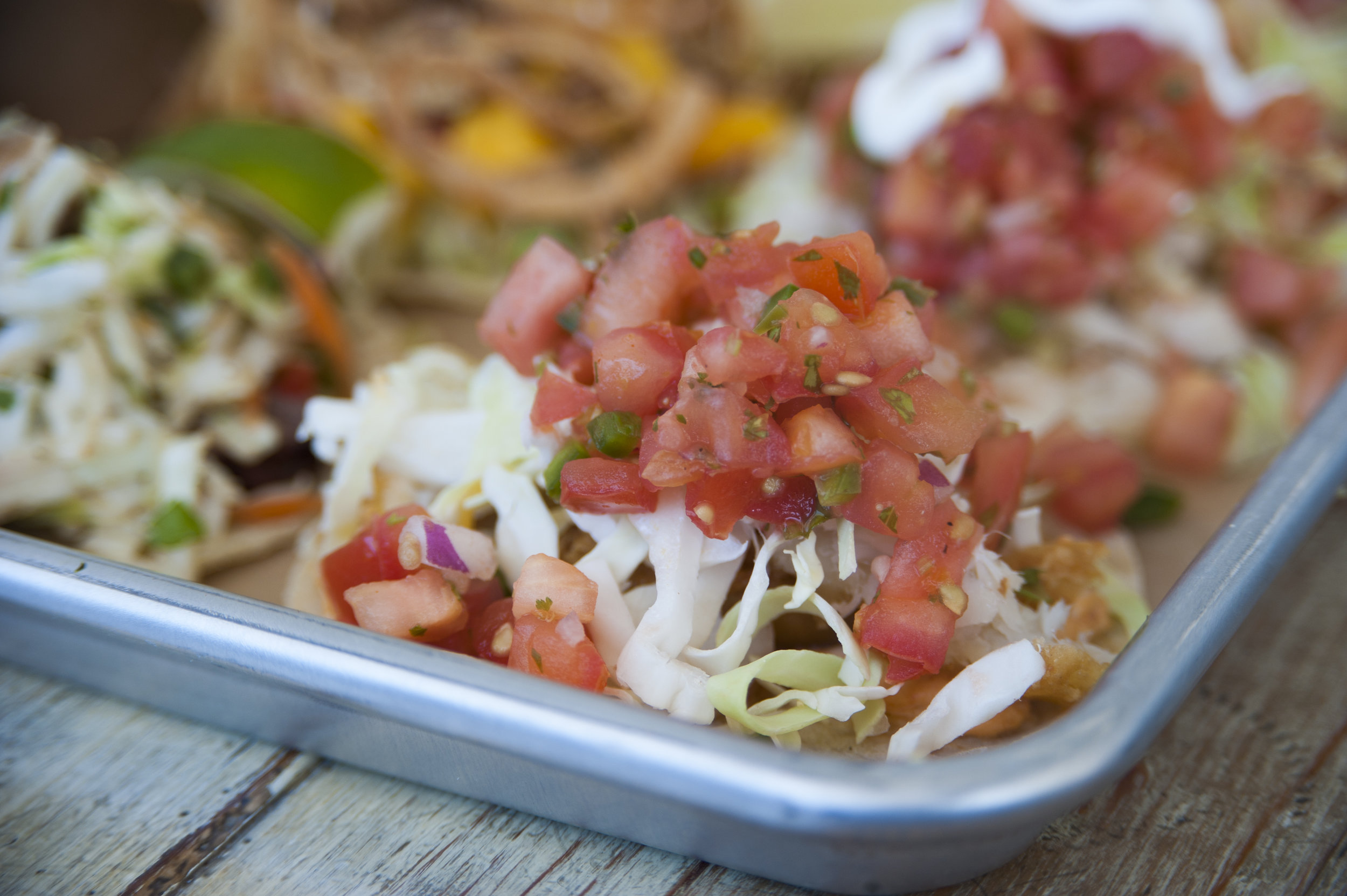 The Crispy Fish taco is accented with invigorating fresh tomato cilantro salsa, shredded cabbage and a three-chili spread.