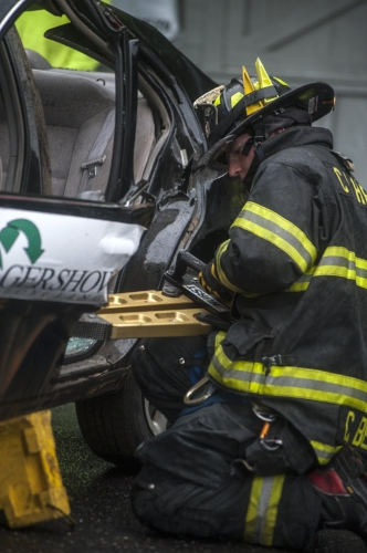 Long Islander News photo/David Weber  A Cold Spring Harbor digs in during the 10th annual Chuck Varese Vehicle Extrication Tournament.