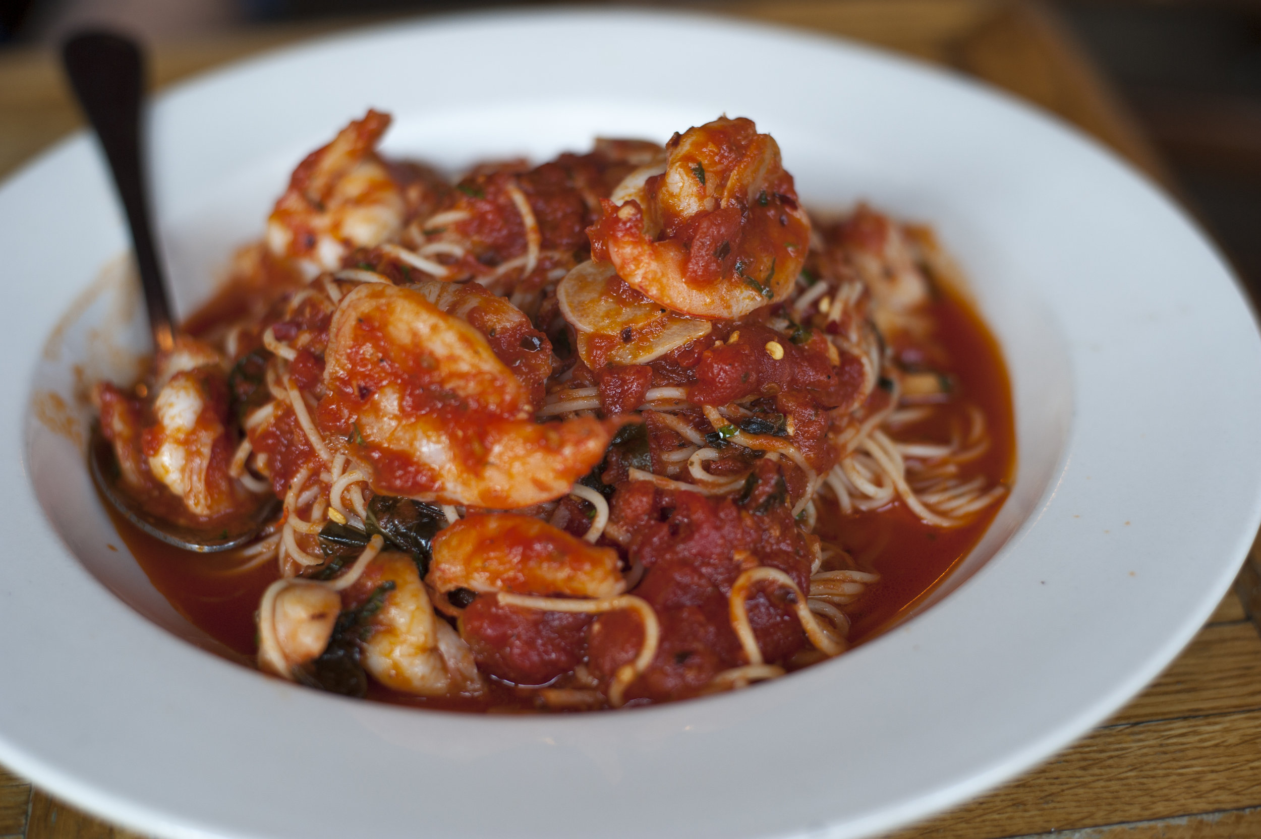 The Shrimp Fra Diavolo features a silky smooth angel hair pasta with perfectly cooked shrimp for a pasta entree to remember, steeped in a generous helping of slightly spicy marinara sauce.