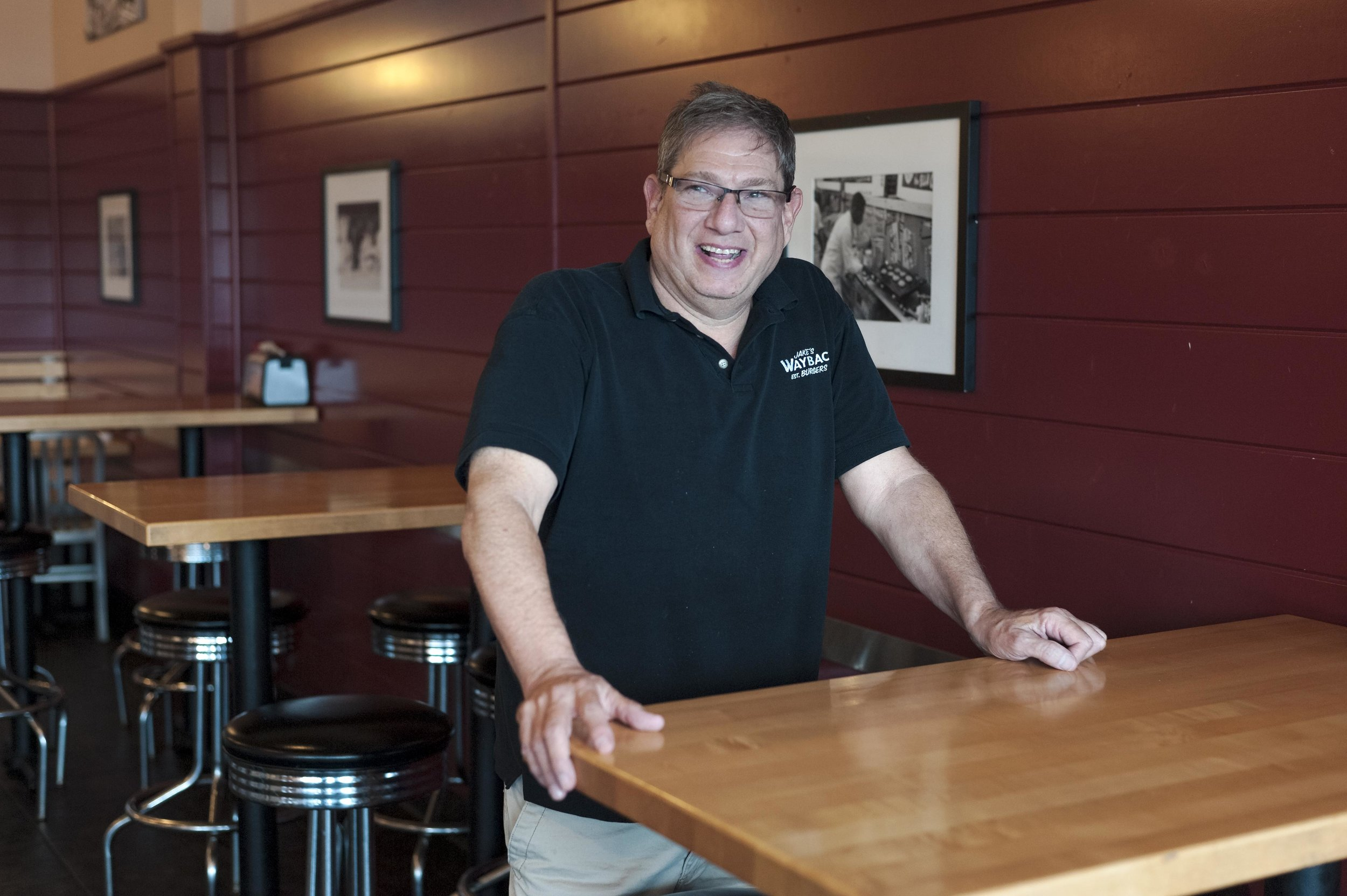 "Long Islander News photos/David Weber  Howie Zeller, owner of the Wayback Burgers location in East Northport, aims to provide diners ""fresh burgers, old fashioned service, made how it used to be made."""