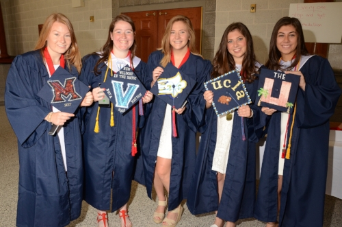 Members of the Cold Spring Harbor 2017 graduating class are all smiles as they hold up their decorative caps.