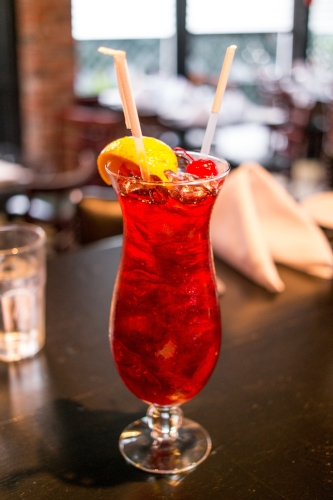 To cool off, order a Hurricane, which is a mix of dark rum and Pat O'Brien's Hurricane Cocktail Mix, straight from the Pelican State.