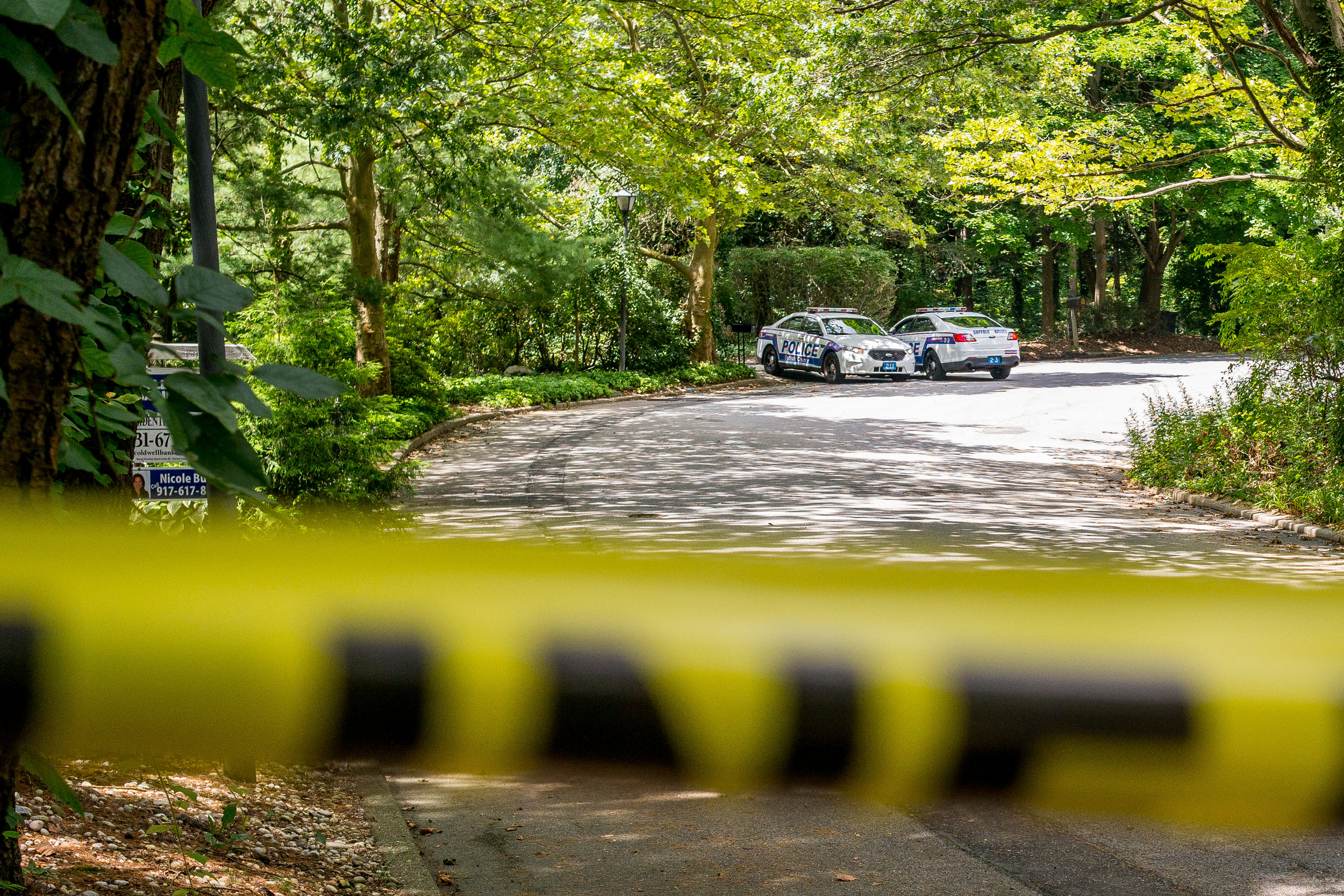 Police cruisers are pictured Wednesday morning on Holly Court in Melville after twin 3-year-old boys drowned in the backyard pool of a home on the street .  Long Islander News photo/Jano Tantongco