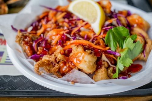 For an Eastern spin on a fried classic, the Kung Pao Calamari generous drizzles sweet chili sauce and slices of carrots and red cabbage over hearty cuts of squid