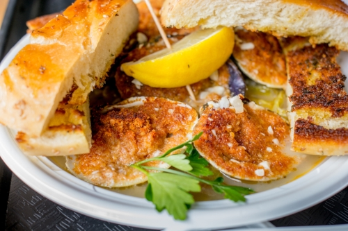 Try the Whole Baked Clams for a tasty treat of garlicky proportions, served with crunchy slices of garlic bread.