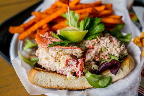 A flagship item, the Homemade Lobster Roll is served as an open sandwich on a warm, locally-sourced brioche roll with crunchy sweet potato fries.