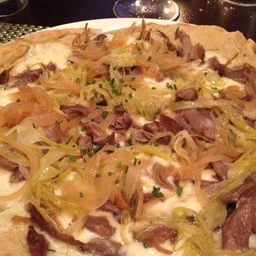 Jewel's duck confit pizza with leeks and caramelized onions.