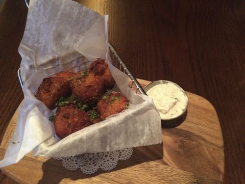 Foie Tots ($11), made of potato mixed with foie gras and served with a side of homemade horseradish sauce, are crunchy on the outside and creamy on the inside.   Long-Islander News photo/Connor Beach