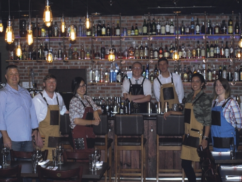 Bar and wait staff at Hush in Huntington village with manager Randy Warren, left.   Long-Islander News photo/Connor Beach