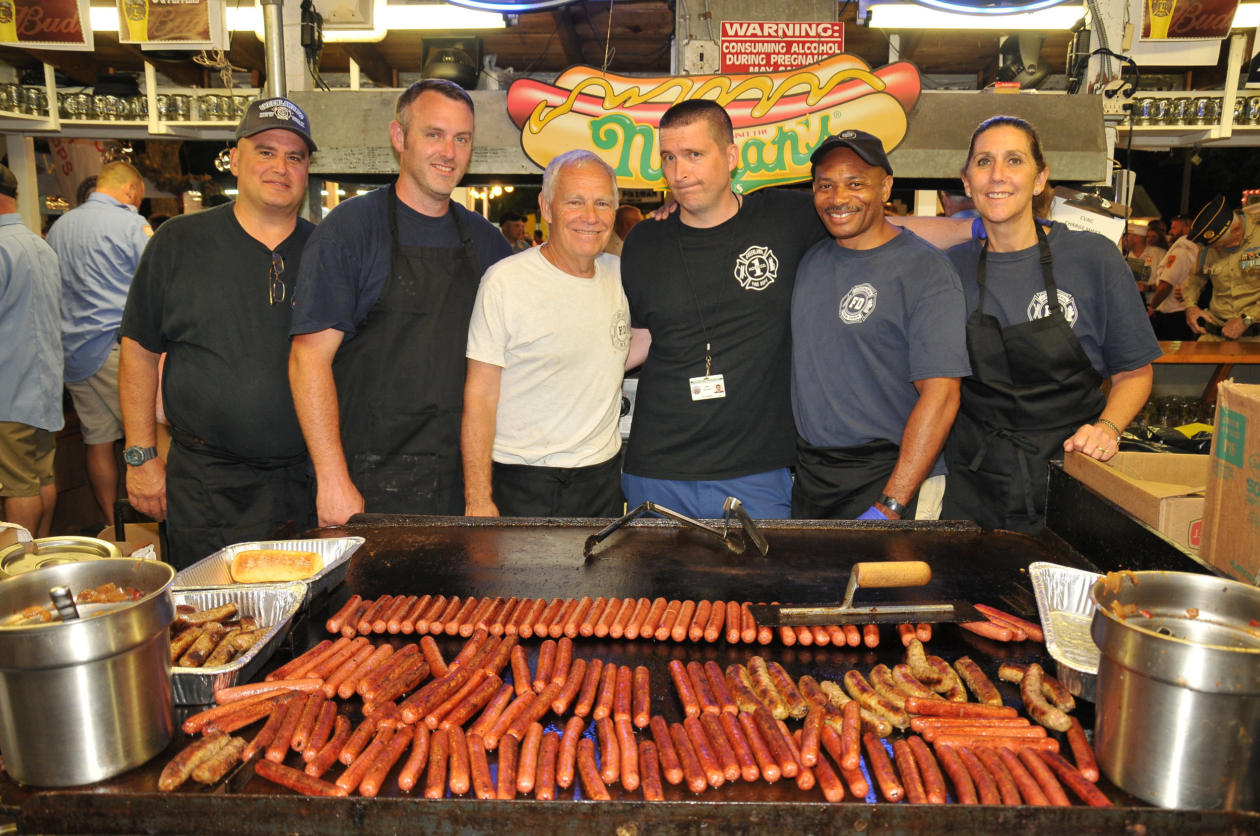 There was plenty of food at the fair, including these hot dogs and sausages cooked up by Greenlawn firefighters.   Photo Courtesy of Steve Silverman