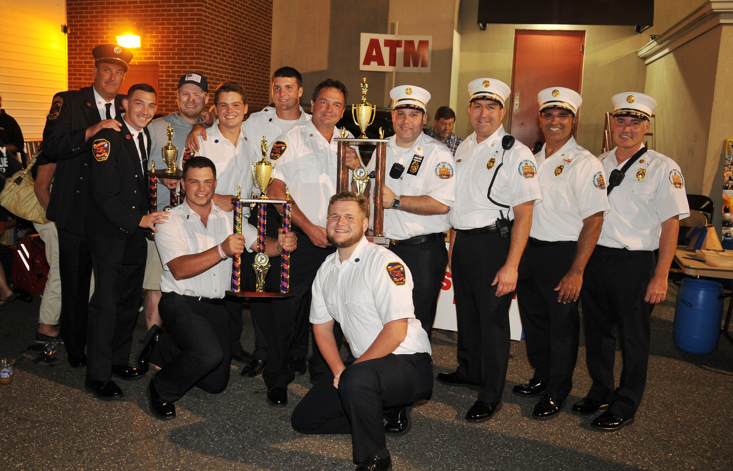 Centerport Fire Chief Tom Boyd and firefighters receive trophies from Greenlawn Fire Chief Mike Bellis and his assistant chiefs for Centerport's participation in this year's parade.   Photo Courtesy of Steve Silverman