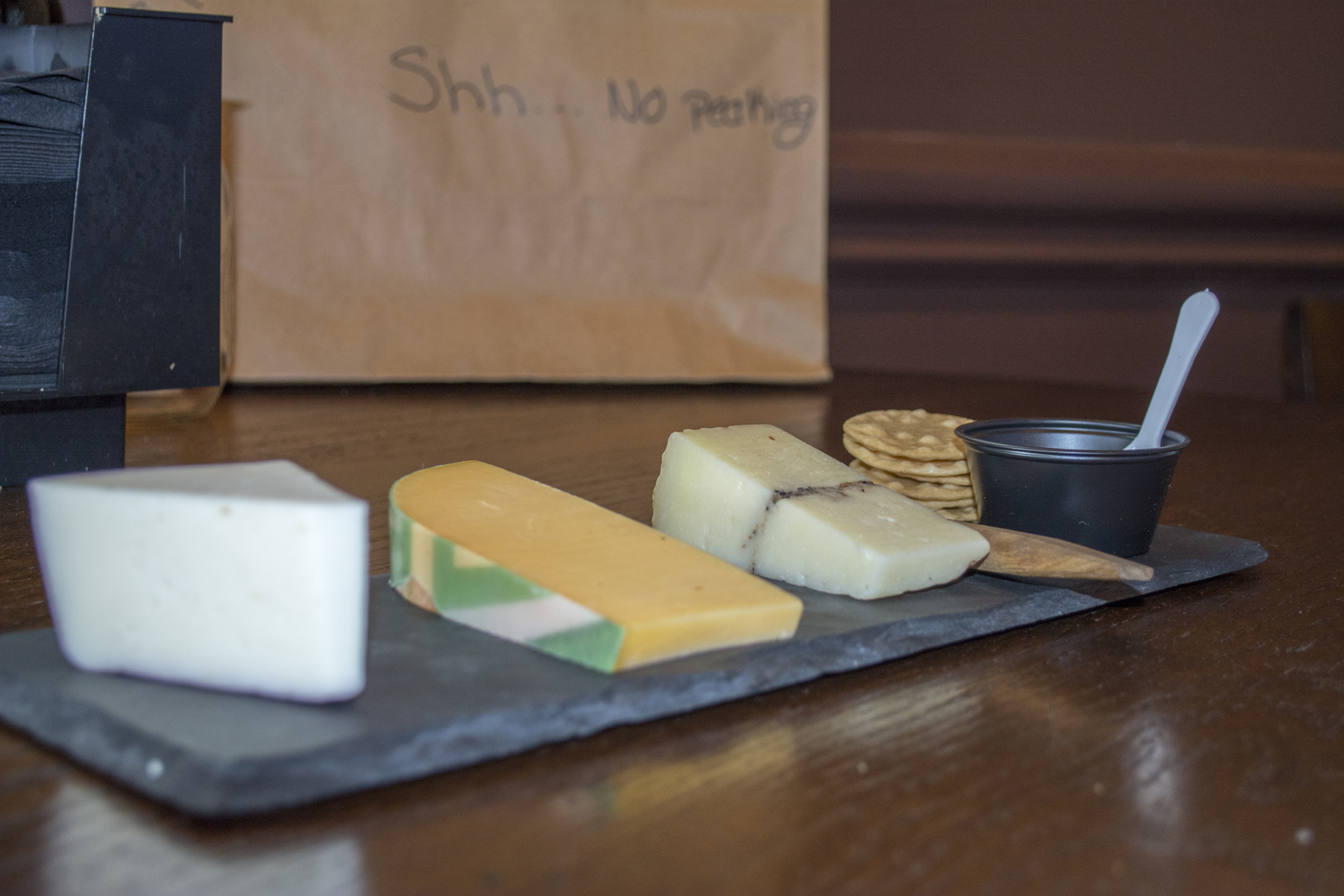 The Cheese Board ($18) features, from left, a red wine goat cheese, a yellow Gouda and a sheep's milk cheese with truffle.   Long Islander News photos/Barbara Fiore