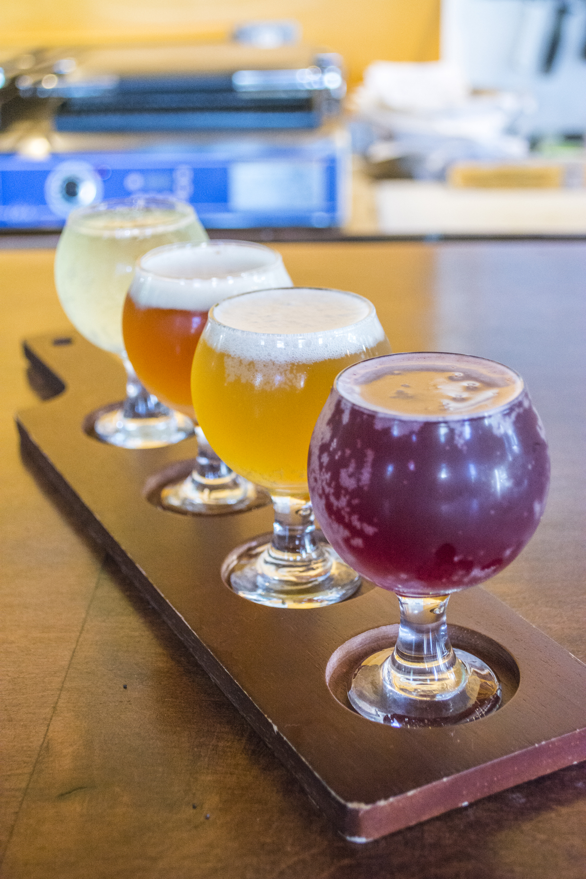 This beer flight includes, front to back, a blueberry sour ale, oat pale ale, pumpkin ale and hard cider.   Long Islander News photos/Barbara Fiore