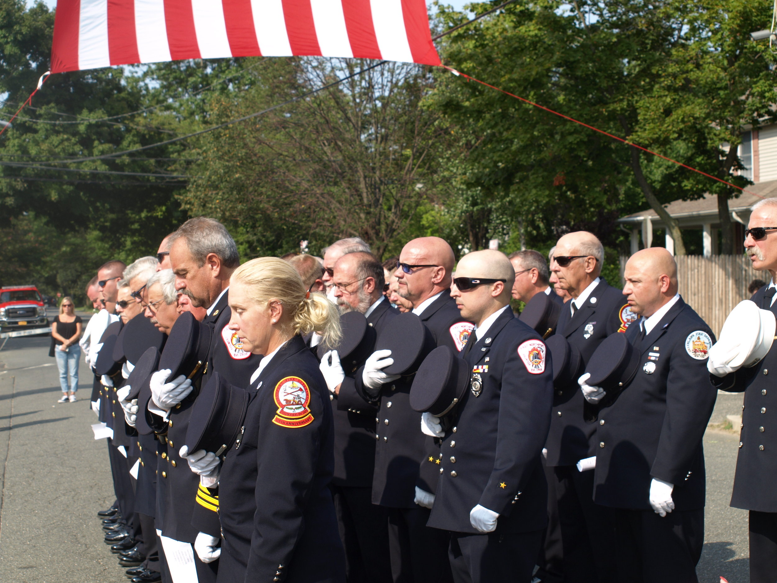Firefighters and police officers from Long Island and New York City join East Northport firefighters to remember the victims of the terrorist attacks.   Long Islander News photos/Connor Beach