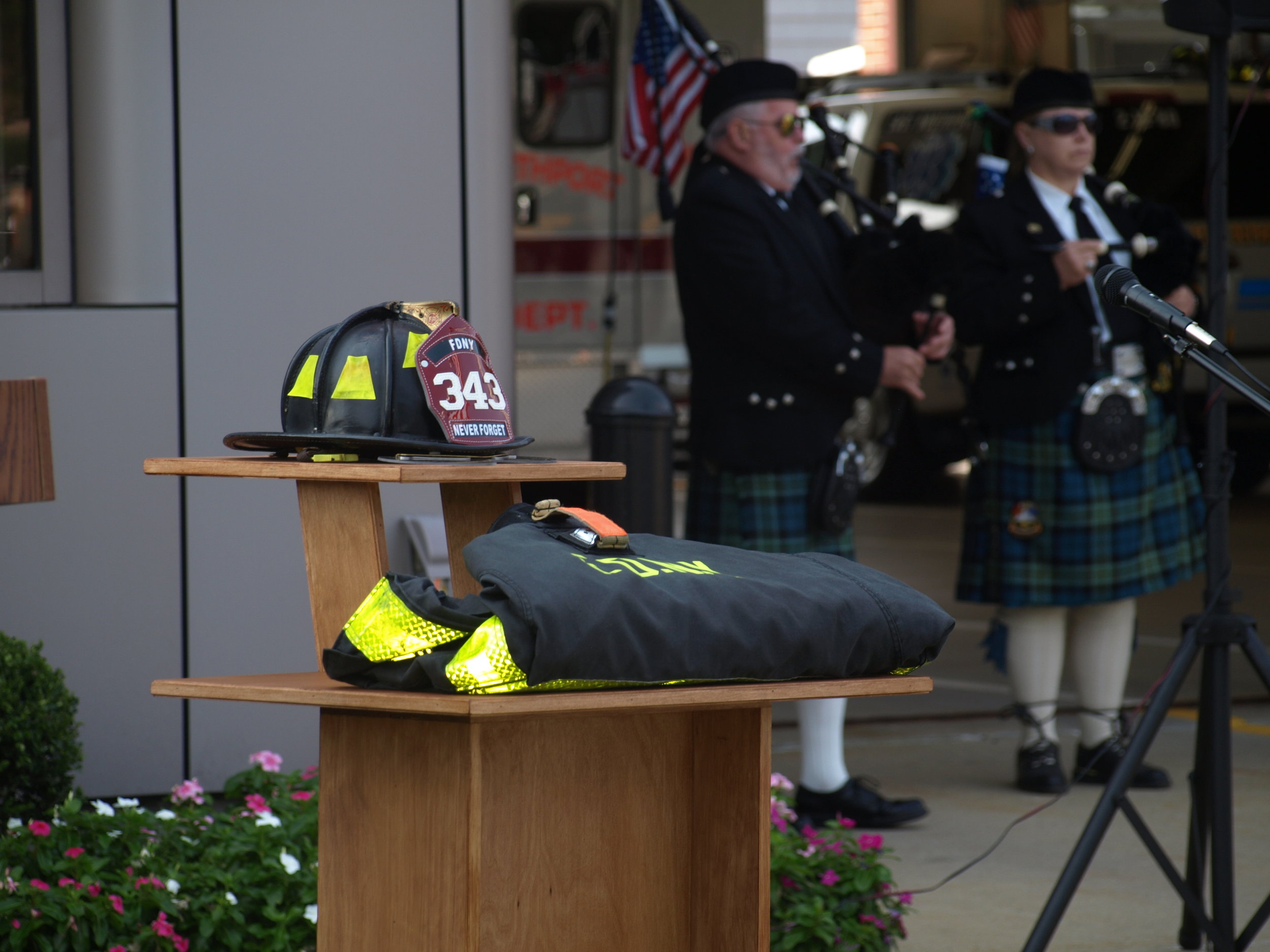 An FDNY uniform displayed the number of firefighters who died at the World Trade Center, 343, as the Northport Pipe Band performed Amazing Grace.   Long Islander News photos/Connor Beach