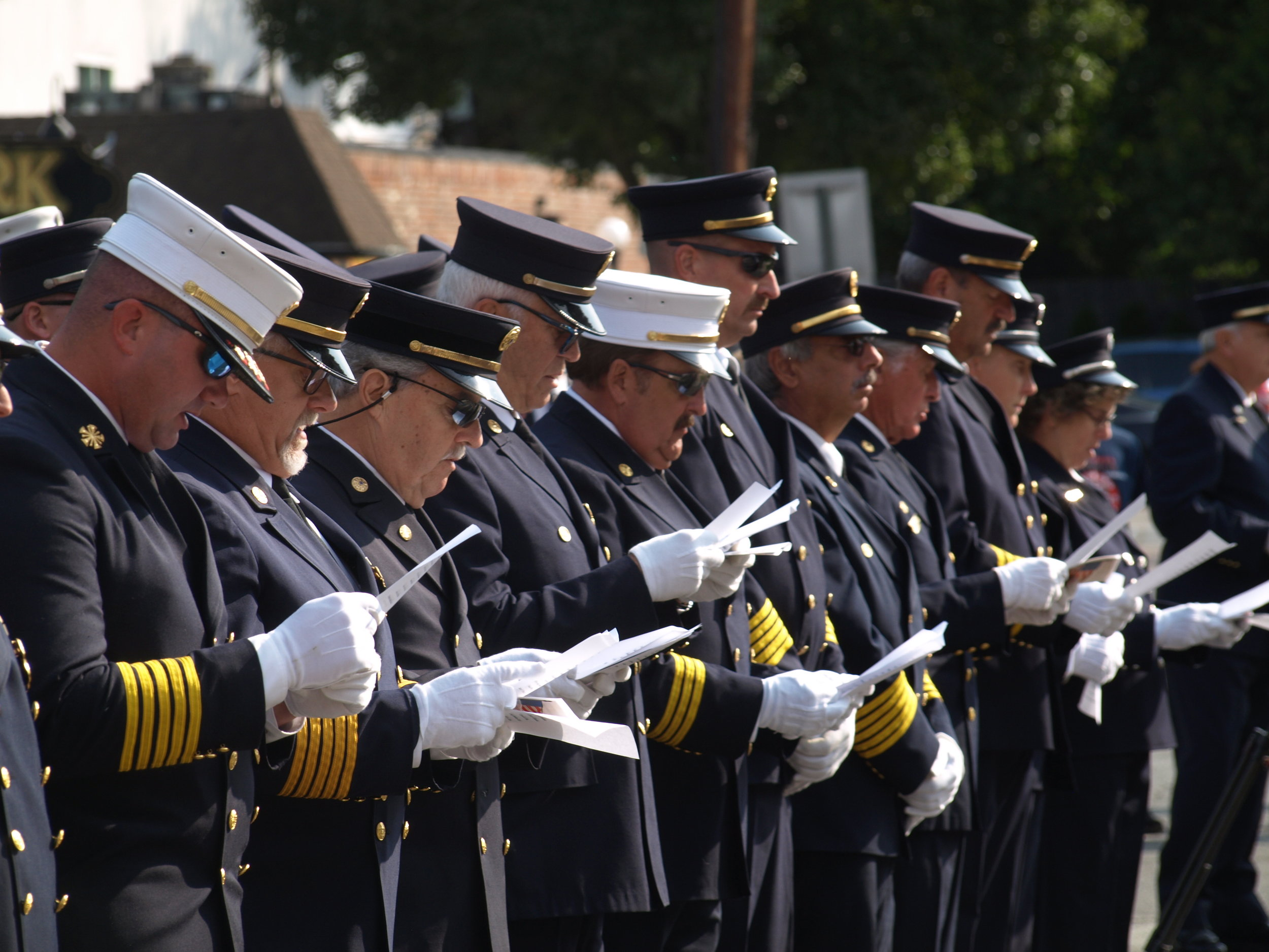 Firefighters read the names of all 2,977 people who died in the Sept. 11 attacks.   Long Islander News photos/Connor Beach