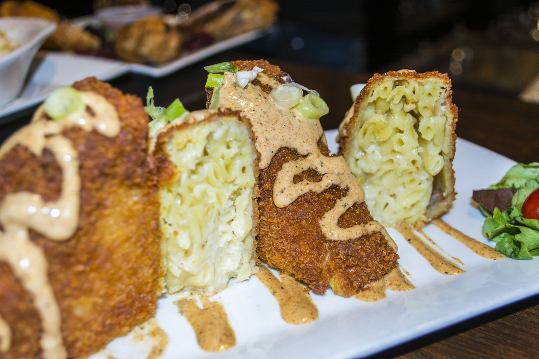 The Fried Mac and Pepper Jack ($8) is drizzled with Cajun ranch sauce.