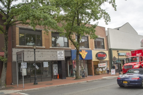Developer Larry Weinberger plans to add 10 apartments to the second floor of 355 New York Ave., which also has three retail storefronts, including Super Runners Shop, on the ground floor.   Long Islander News photo/Andrew Wroblewski