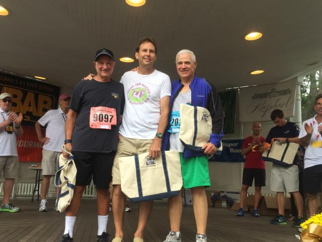 Marc Krieg, Bill Oehrlein, and Jerry Asher have been running the Great Cow Harbor 10K Run since its inception in 1977.     Photo courtesy of Hon. Jerry Asher