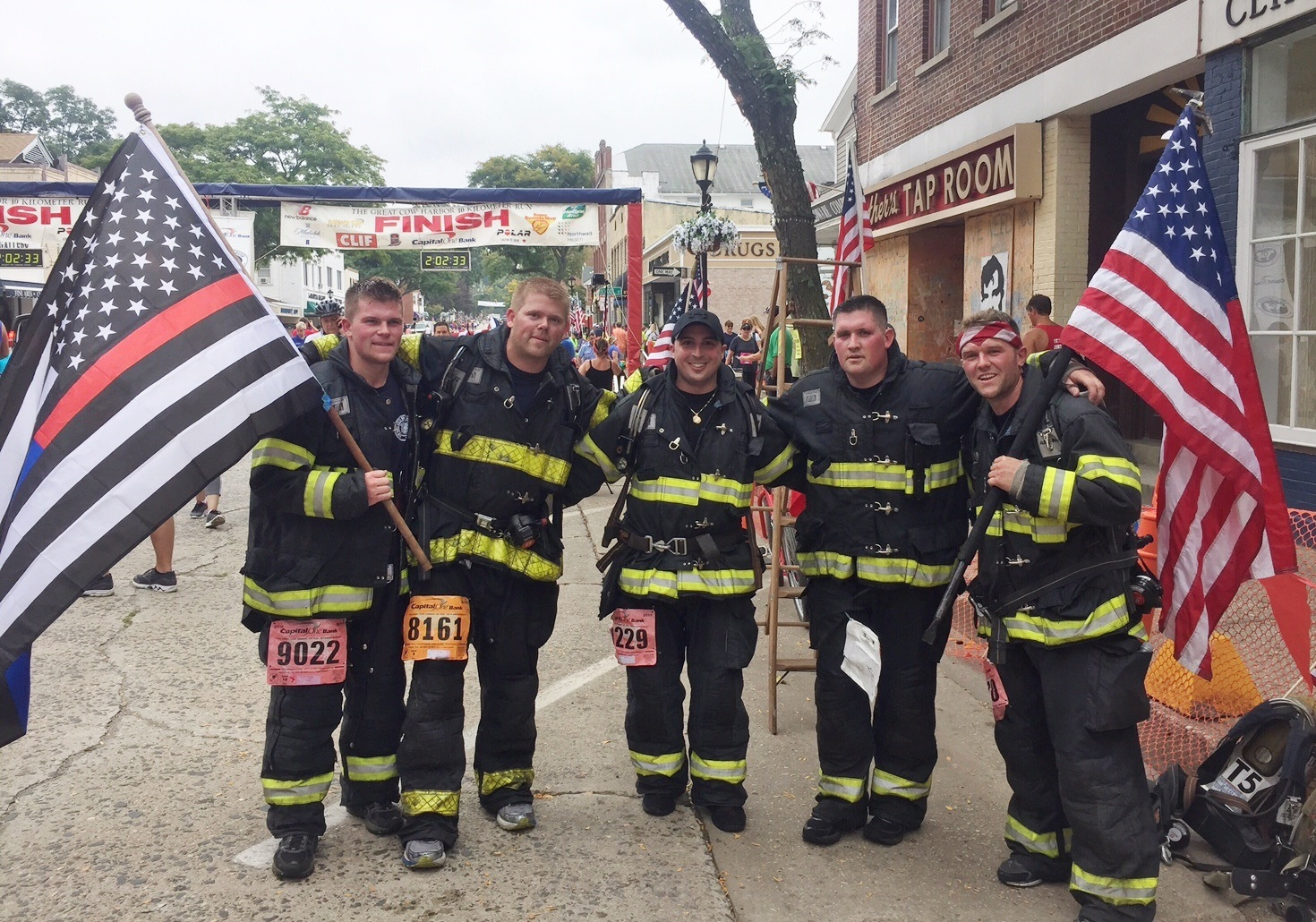 Five local firefighters, from left, Mike Gunther, Dan Cross, Lieutenant Vinny Pastore, Jamie Conroy, and Mike Ripple completed the race wearing 50 pounds of structural firefighting gear and a self-contained breathing apparatus.   Photo/East Northport Fire Department