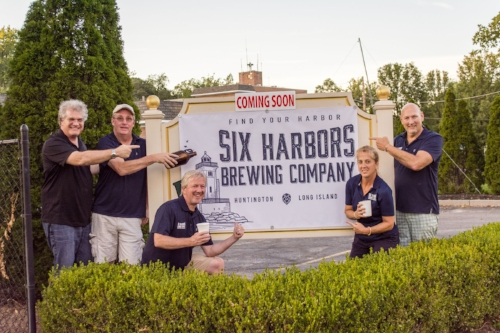 Six Harbors Brewing Company founders Mark and Karen Heuwetter are joined by investor Chris Bluemer; beer lover and friend Sal LoPinto; and investor Jim Murray.   Long Islander News photo/Andrew Wroblewski