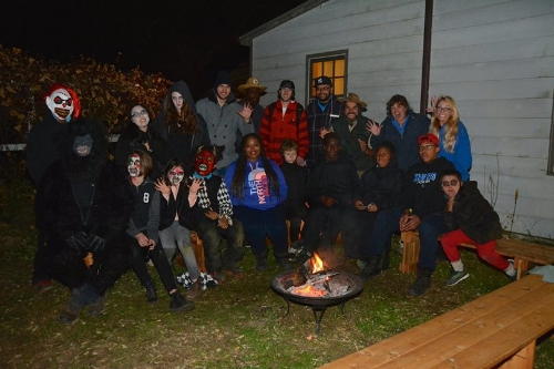 Volunteers from the Manor Farm Haunted Trail celebrate a successful night of scaring visitors at the farm.   Photo courtesy of Rich Brundige