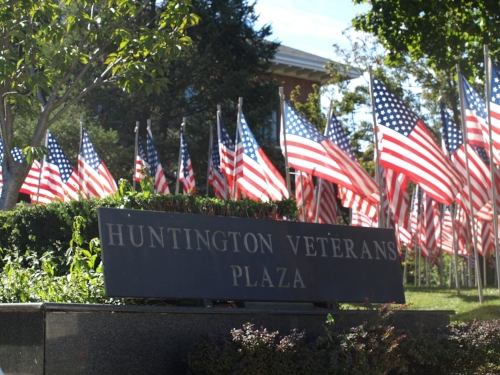 Hundreds of American flags surround Huntington Veterans Plaza on the front lawn of Huntington Town Hall.