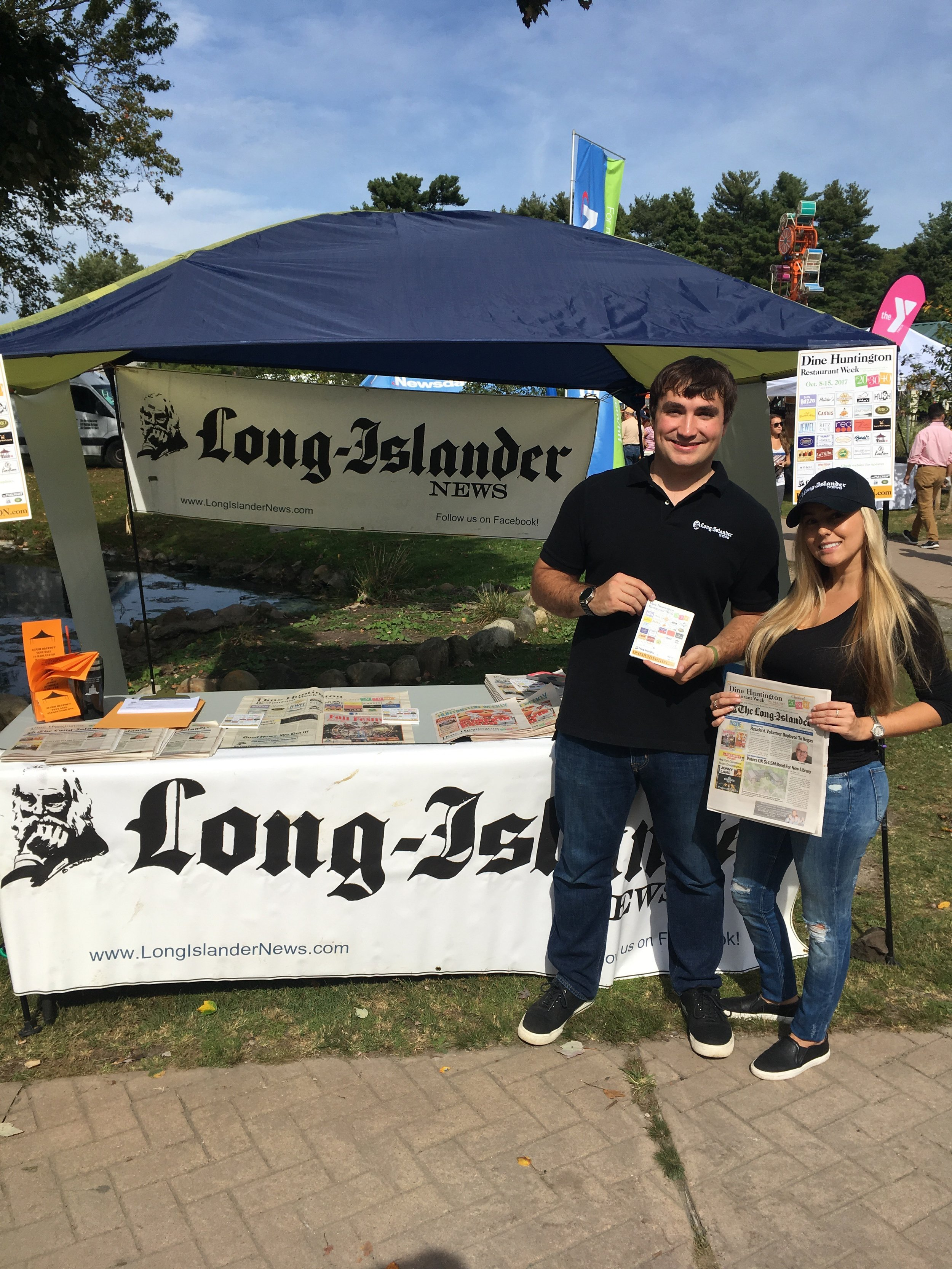 The Long-Islander team, including editor Andrew Wroblewski and volunteer Diana Murillo, handed out info on Dine Huntington Restaurant Week, running from Oct. 8-15, at the Long Island Fall Festival.   Long Islander News Photos/Paul Shapiro