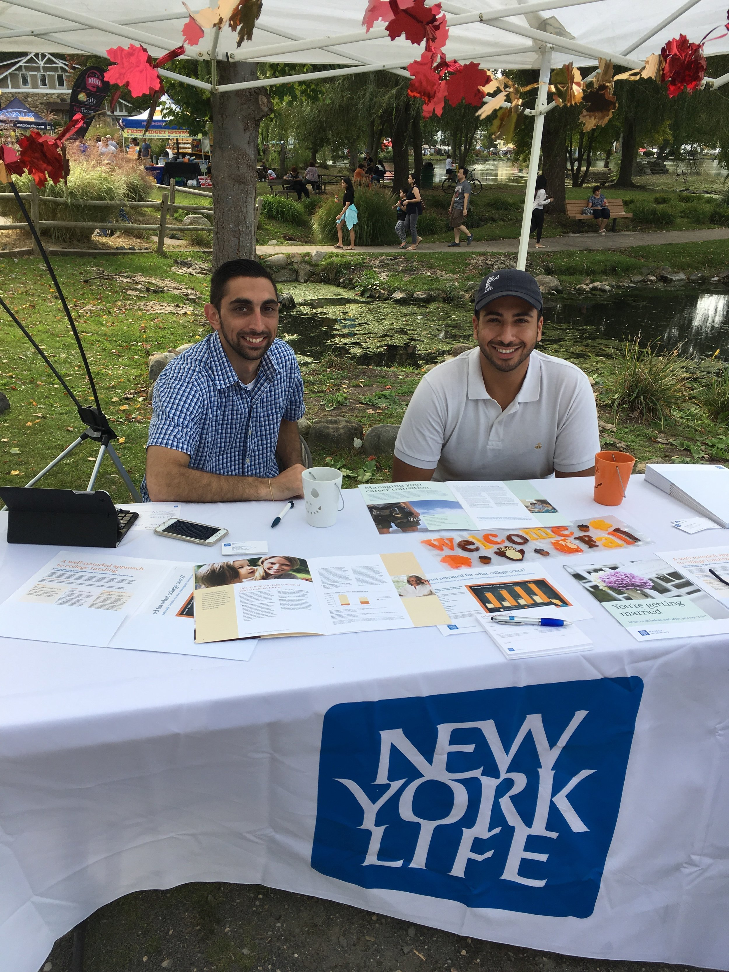Michael J. Rhatigan and Kareem Abdelmagid, of New York Life Insurance Company in Melville, at their booth during the Long Island Fall Festival.   Long Islander News Photo/Paul Shapiro