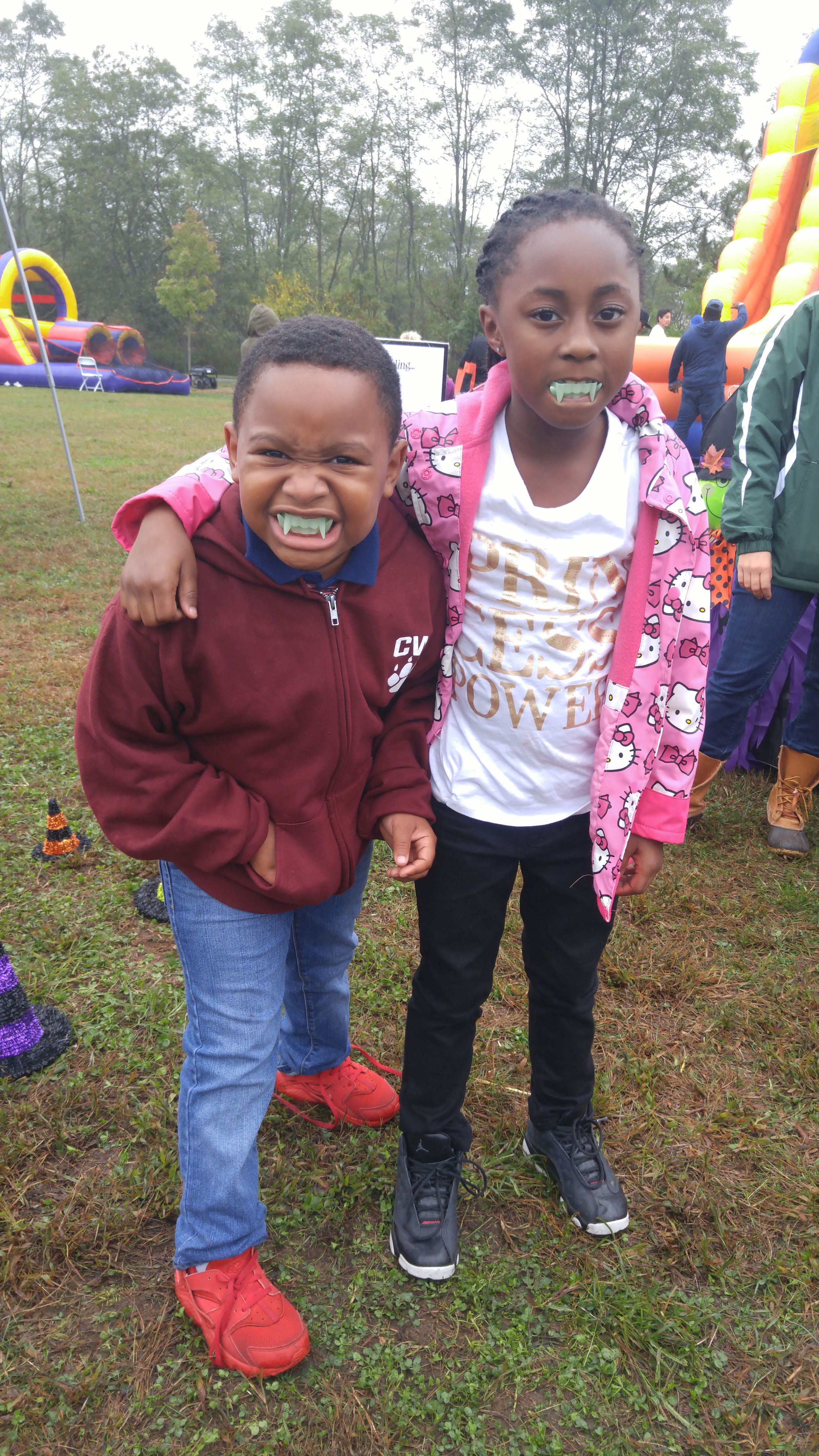 "Kids show off their winning vampire smiles after the Harborfields Alumni and Community Educational Foundation's ""Ring Around the Witches Hat.""   Photo Courtesy of Rachael Risinger"