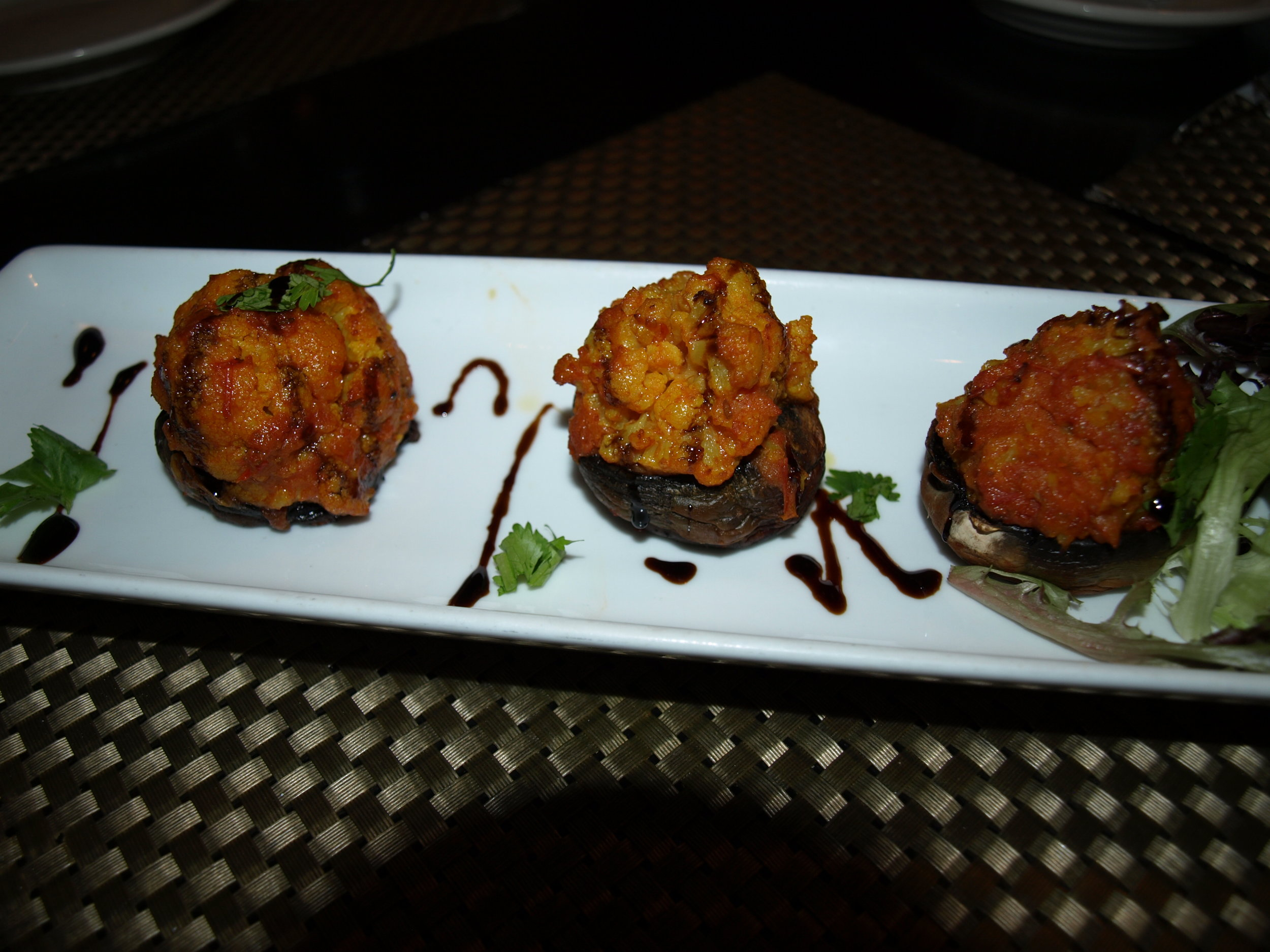 The Stuffed Vegetable Mushrooms ($12) are filled potato and cauliflower and drizzled with a balsamic reduction.   Long Islander News Photo/Connor Beach