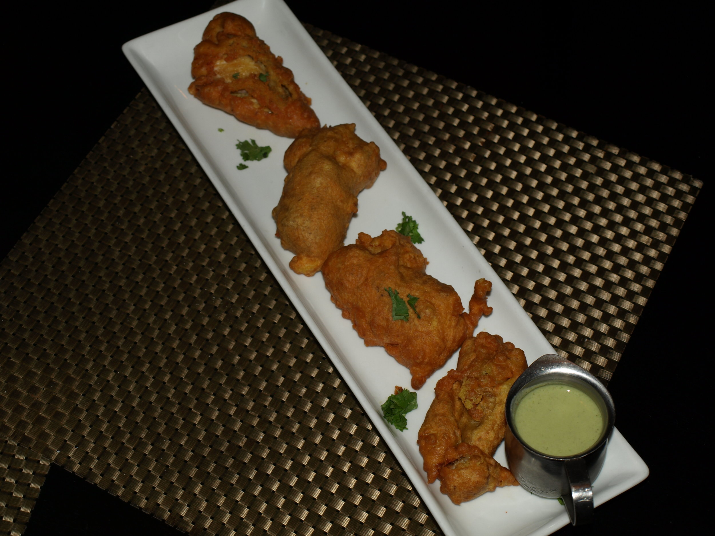 The Bombay Fritters ($12) are fish fried in a chickpea batter served with a mint and green chili chutney sauce.   Long Islander News Photo/Connor Beach