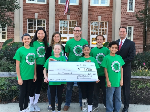 Members of Oldfield Middle School Student Government, with advisors Kristen Presi and Chris Havranek (center), and Assistant Superintendent for Administration and Human Resources Rory Manning (right), will present a $1,000 check to AdoptAClassroom.org  , which assists schools impacted by the recent hurricanes.   Photo Courtesy of Harborfields Central School District