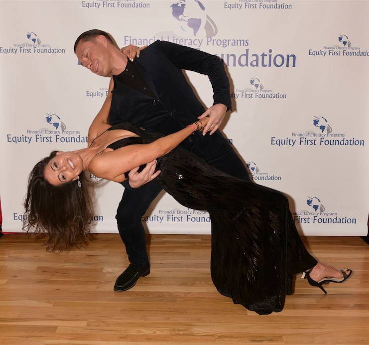 """Christine Montanti, senior editor for Social Life Magazine and publicist for the Fred Astaire Dance Studio, and Dimitriy Saykovskyy, professional ballroom dancer and co-owner of Fred Astaire Dance Studio, strike a pose during the """"Dancing For A Cure"""" charity event.   Photo by Rob Rich"""