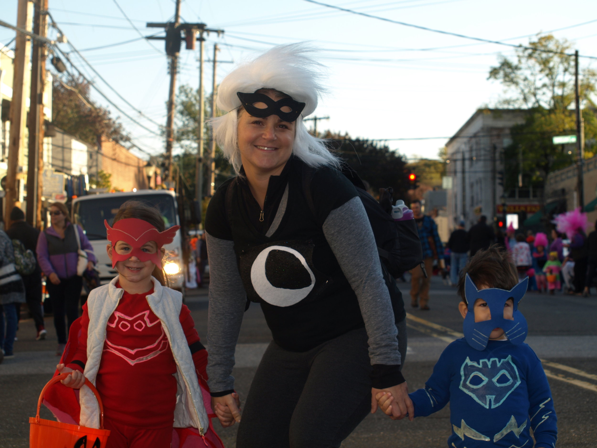 A trio of super heroes kept a watchful eye over the trick-or-treaters at the Town's Halloween Parade.  Long Islander News Photo/Connor Beach