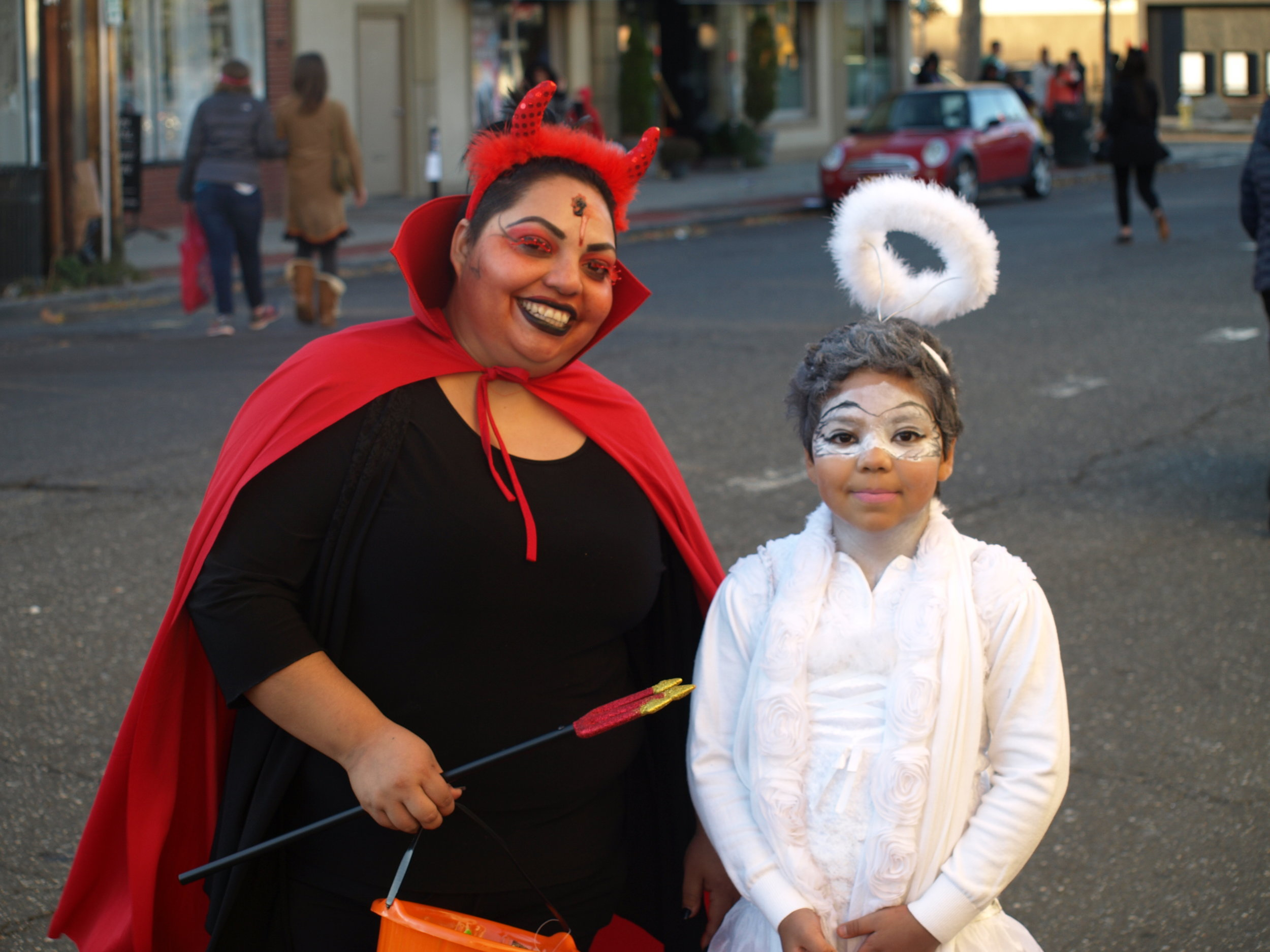 Devils and angels got to share in the Halloween spirit when merchants on Wall Street opened their doors to trick-or-treaters on Halloween.  Long Islander News Photo/Connor Beach