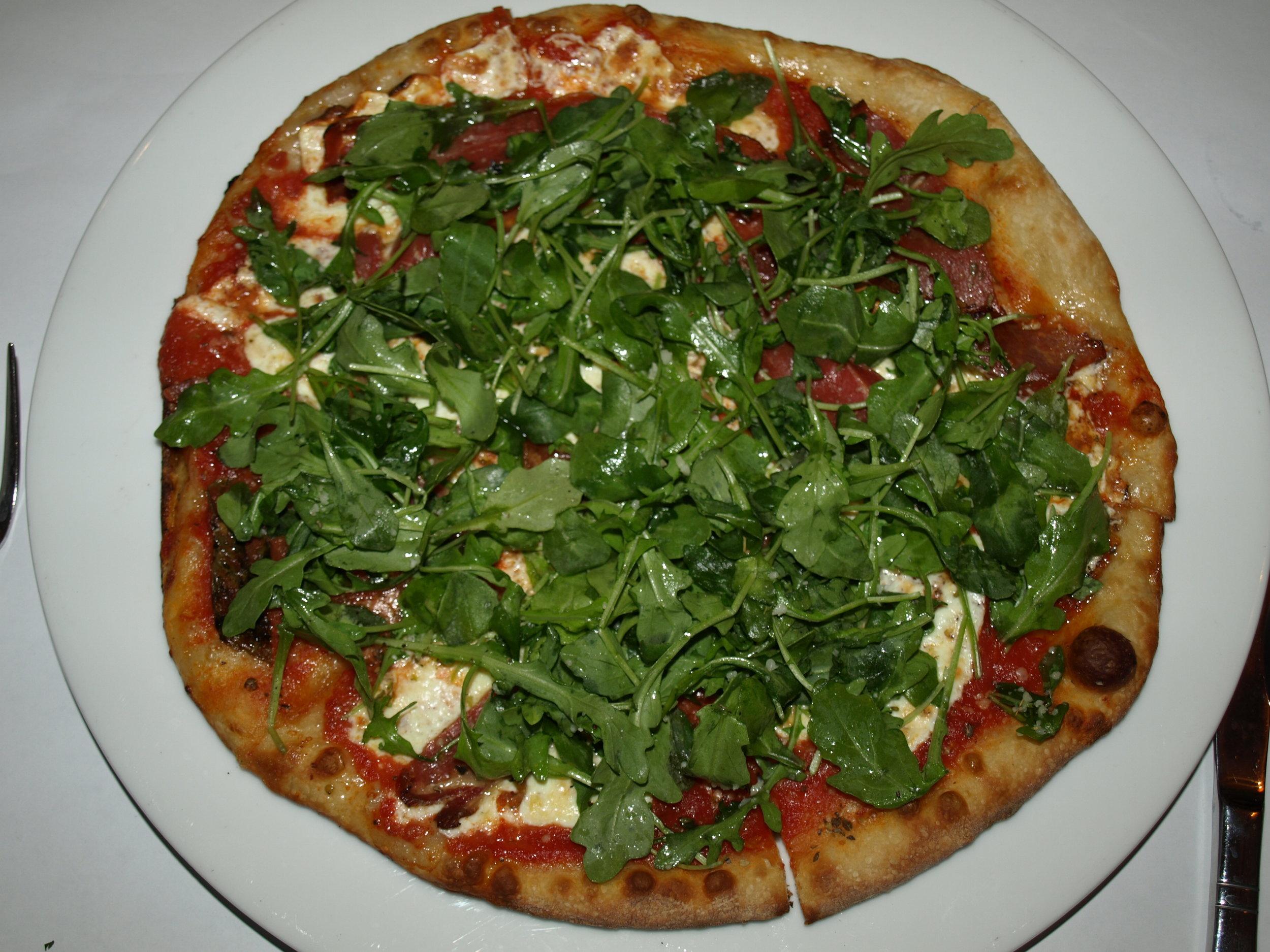Pizzette Porto Fino ($13.95) is a thin crust pizza with fresh mozzarella, prosciutto, plum tomato sauce, baby arugula and truffle oil.   Long Islander News Photo/Connor  Beach