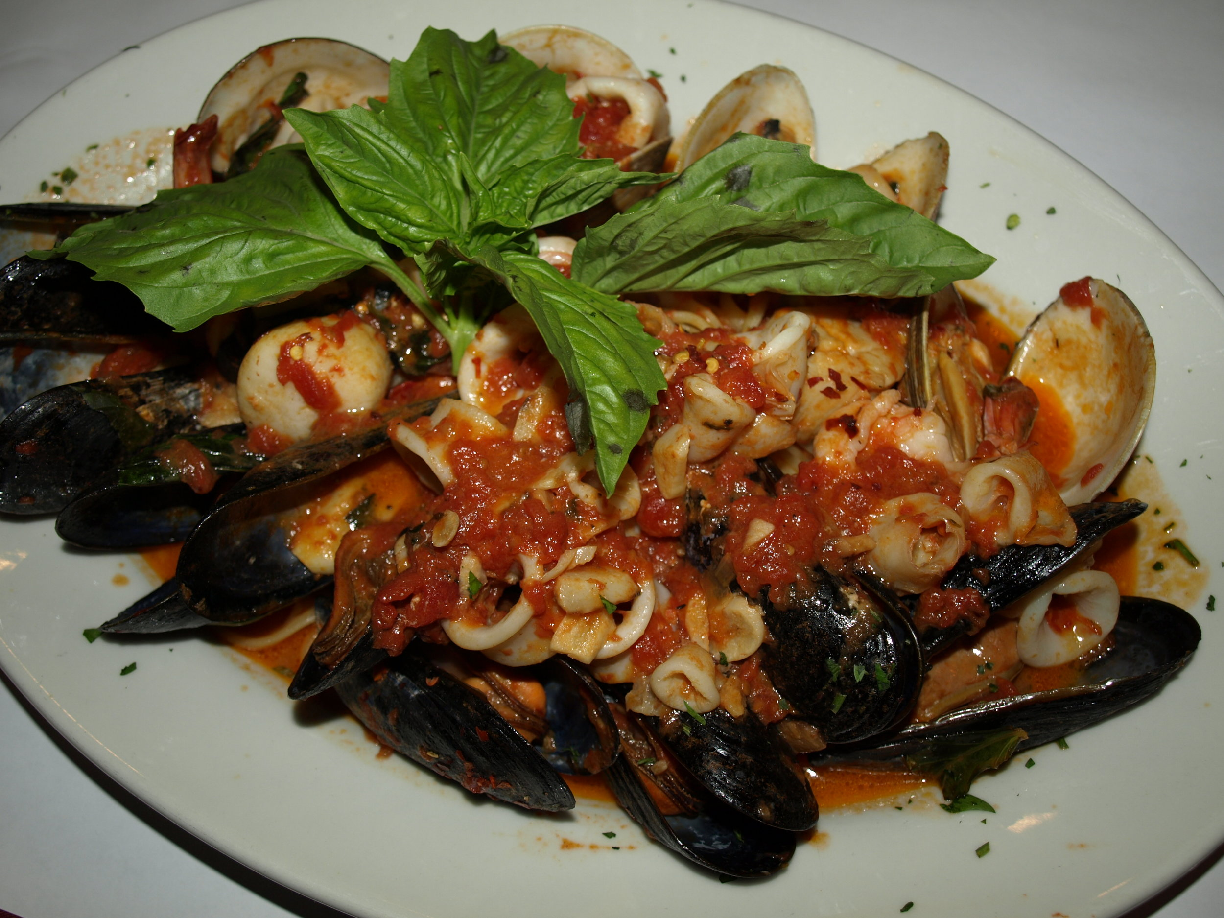 Seafood Fra Diavolo ($26.95) features a heaping platter of shrimp, mussels, clams, calamari and scallops sautéed in a spicy fra diavolo sauce on top of linguine.   Long Islander News Photo/Connor Beach