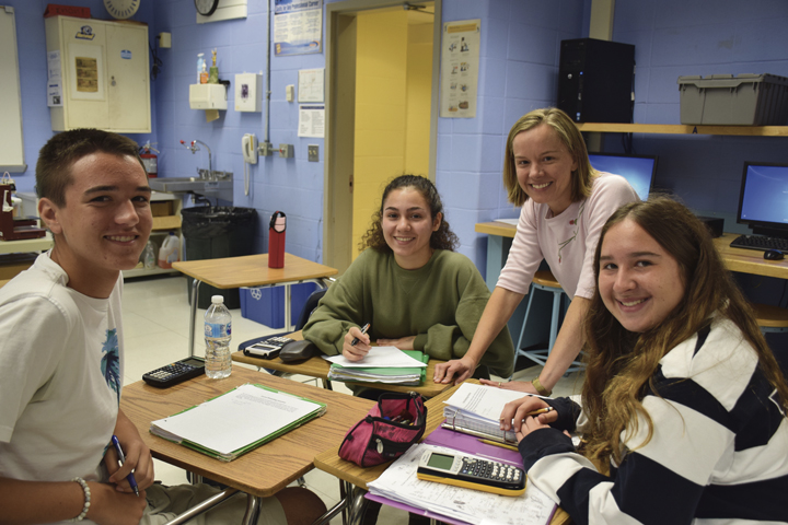 Kristen Rozell, second from right, a newly selected New York State Master Teacher, with her senior calculus students, from left, Joe Barry, Christina Wing, and Julianne Starzee.   Photo Courtesy of Northport-East Northport School District