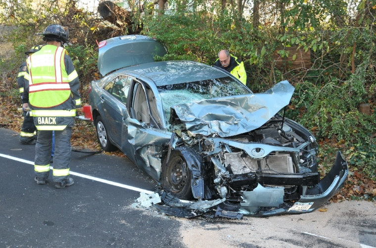 This Toyota sedan was involved in a head-on collision with a Dodge pickup truck on Sunday afternoon in Dix Hills.   Photo by Steve Silverman