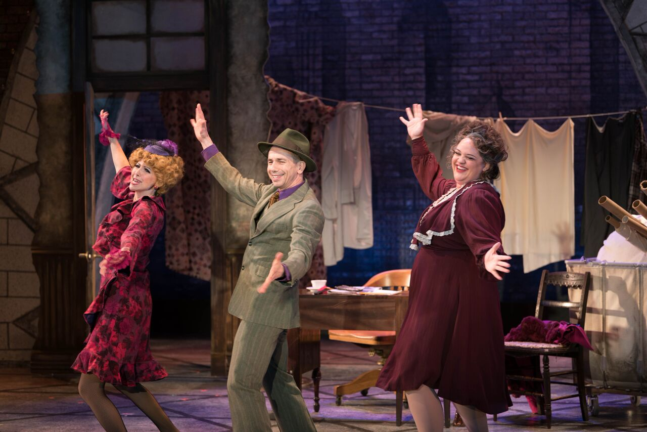 "Gina Milo (as Lily St. Regis), Jon Peterson (as Rooster), and Lynn Andrews (as Miss Hannigan) during a performance of ""Easy Street.""   Photo by Michael DeCristofaro"